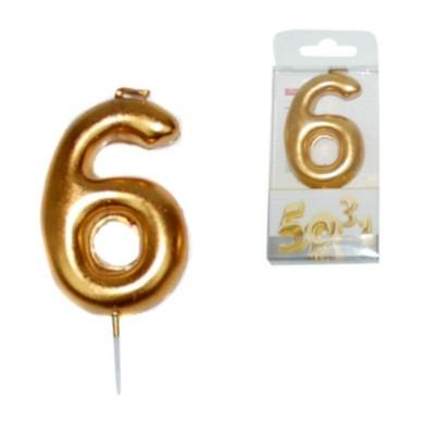 Vela dorada numero 6.
